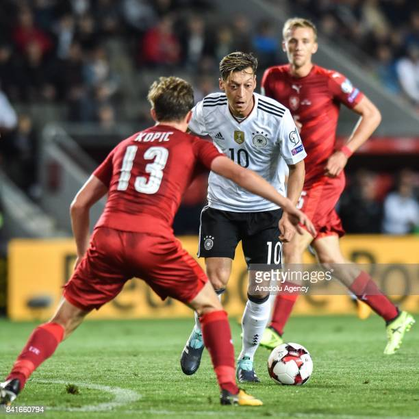 Jan Kopic of Czech Republic in action against Mesut Ozil of Germany during the 2018 FIFA World Cup Qualifications Group C match between Czech...