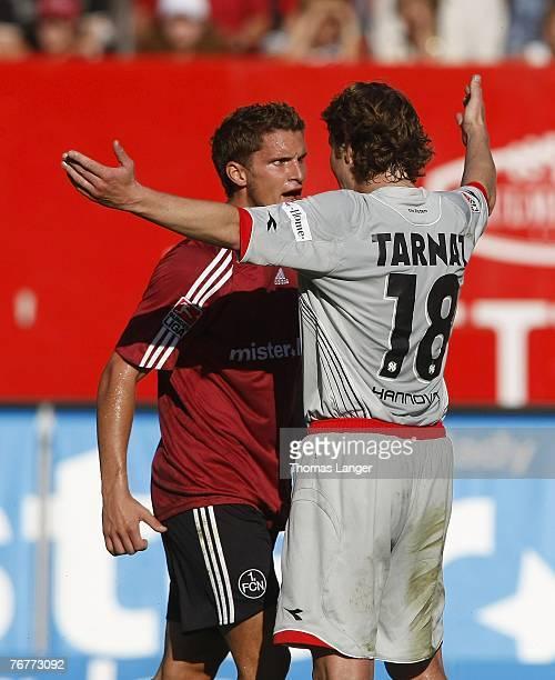 Jan Kristiansen of Nuremberg and Michael Tarnat of Hannover argue during the Bundesliga match between 1FC Nuremberg and Hannover 96 at the EasyCredit...