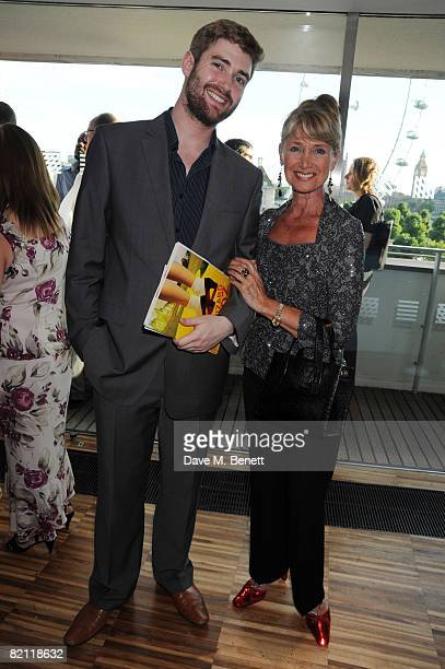 Jan Leeming wearing ruby slippers with guest attends the Swarowski pre party to the opening night of The Wizard of Oz at the Royal Festival Hall on...
