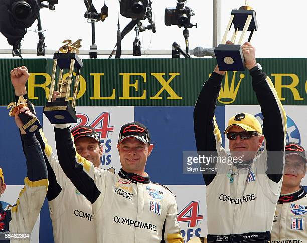 Jan Magnussen Denmark and Doug Fehan of Team Corvette Racing celebrate on the podium after winning the LMGT1 class at Le Mans 24h race on June 14...