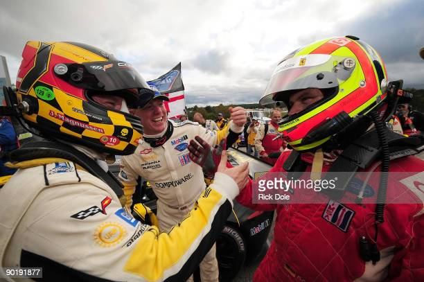 Jan Magnussen driver of the Corvette Racing C6R and Pierre Kaffer driver of the Risi Competizione Ferrari 430 GT congratulate each other in victory...