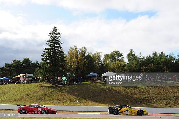 Jan Magnussen in the Corvette Racing C6R leads Pierre Kaffer in the Risi Competizione Ferrari 430 during the American Le Mans Series Mobil 1 Presents...