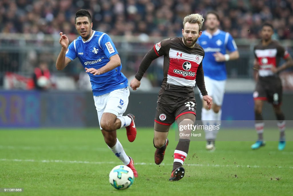 Jan Marc Schneider (R) of Pauli and Slobodan Medojevic (L) of Darmstadt compete for the ball during the Second Bundesliga match between FC St. Pauli and SV Darmstadt 98 at Millerntor Stadium on January 28, 2018 in Hamburg, Germany.