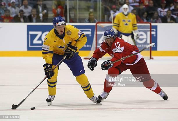 Jan Marek of Czech Republic and David Rundbald of Sweden battle for the puck during the IIHF World Championship semi final match between Czech...