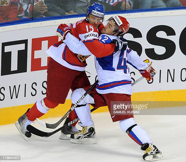 Jan Marek of Czech Republic fights for the puck with Sergei Zinoviev of Russia during the IIHF Ice Hockey World Championship Qualification Round...