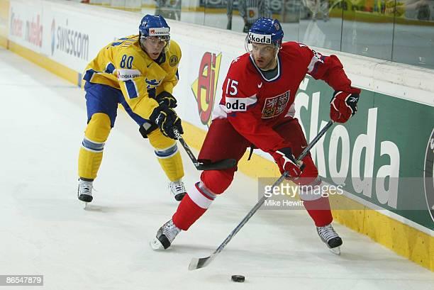 Jan Marek of Czech Republic is hooked by Mattias Weinhandl of Sweden during the IIHF World Championship QuarterFinal between Sweden and Czech...