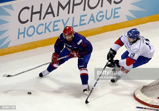 Jan Marek of Metallurg Magnitogorsk challenges JeanGuy Trudel of ZSC Lions Zurich during the IIHF Champions Hockey League final game between...