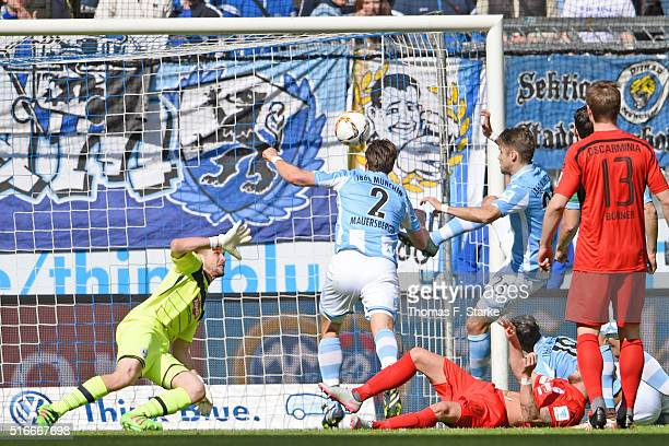 Jan Mauersberger of Muenchen scores his teams first goal against Wolfgang Hesl of Bielefeld during the Second Bundesliga match between 1860 Muenchen...