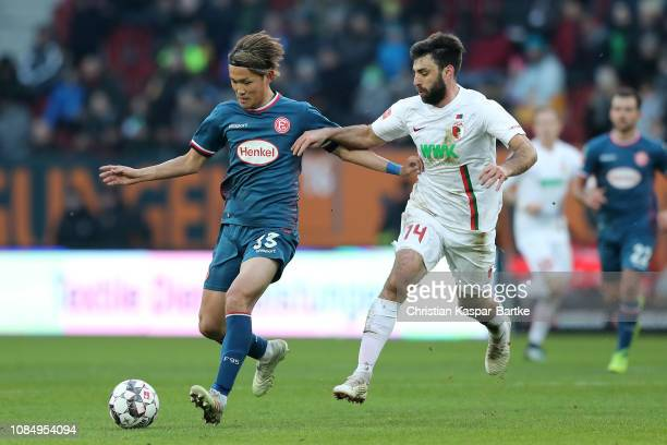 Jan Moravek of Augsburg battles for possesion with Takashi Usami of Fortuna Duesseldorf during the Bundesliga match between FC Augsburg and Fortuna...
