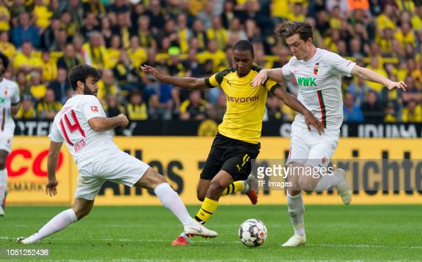 Jan Moravek of FC Augsburg Abdou Diallo of Borussia Dortmund and Michael Gregoritsch of FC Augsburg battle for the ball during the Bundesliga match...