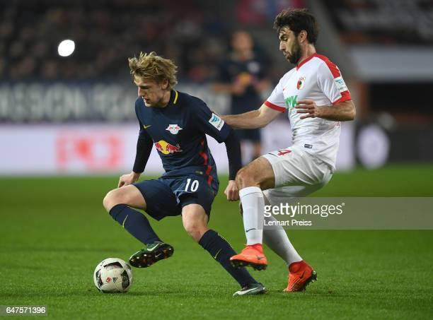Jan Moravek of FC Augsburg challenges Emil Forsberg of RB Leipzig during the Bundesliga match between FC Augsburg and RB Leipzig at WWK Arena on...