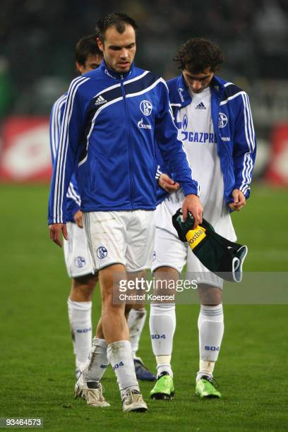 Jan Morávek Heiko Westermann and Halil Altintop of Schalke look dejected after losing 01 the Bundesliga match between Borussia Moenchengladbach and...