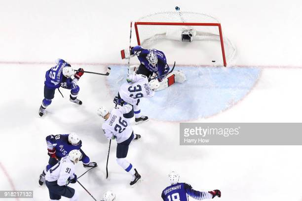 Jan Mursak of Slovenia scores the tying goal against Ryan Zapolski of the United States in the third period during the Men's Ice Hockey Preliminary...
