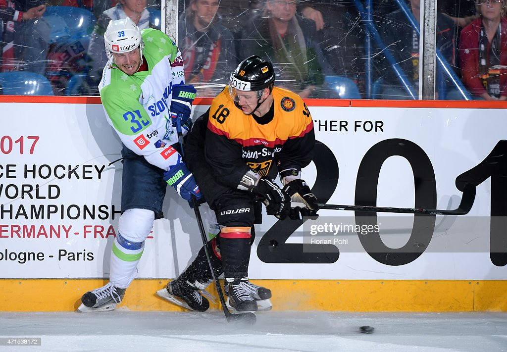 Jan Mursak of Team Slovenia and Kai Hospelt of Team Germany during the game between Germany and Slovenia on april 29, 2015 in Berlin, Germany.
