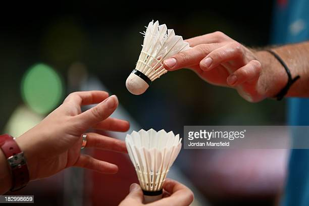 Jan O Jorgensen of Denmark changes the shuttlecock during his mens singles match against Tian Houwei of China during Day 3 of the London Badminton...