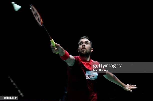 Jan O Jorgensen of Denmark competes in the men's singles match against Lin Dan of China on day two of the Daihatsu Yonex Japan Open Badminton...