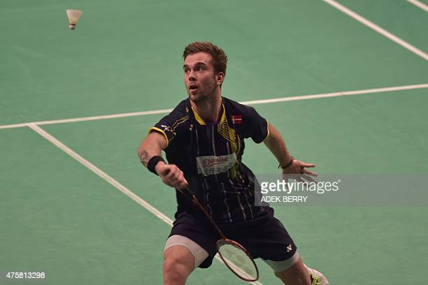 Jan O Jorgensen of Denmark returns a shuttle cock to Indonesian Hayom Dionysius Rumbaka during a qualification in the 2015 Indonesia Open in Jakarta...