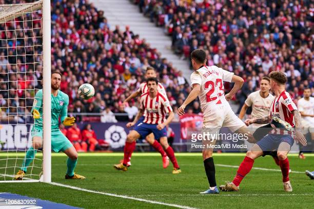 Jan Oblak of Atletico de Madrid and Sergio Reguilon of Sevilla during the Liga match between Club Atletico de Madrid and Sevilla FC at Wanda...