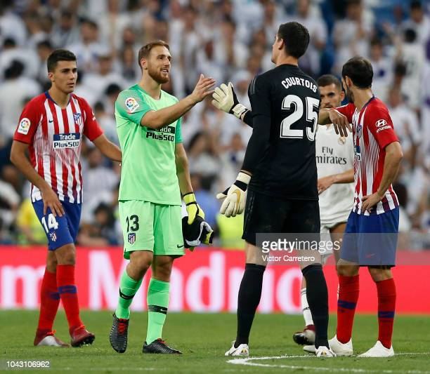 Jan Oblak of Atletico de Madrid and Thibaut Courtois of Real Madrid shakes hands after the La Liga match between Real Madrid and Atletico de Madrid...