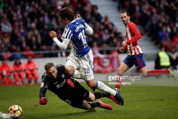 Jan Oblak of Atletico de Madrid in action against Mikel Oyarzabal of Real Sociedad during the La Liga match between Club Atletico Madrid and Real...
