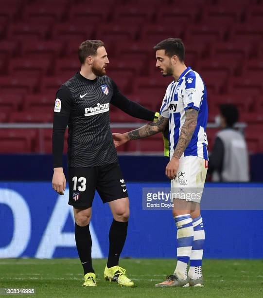 Jan Oblak of Atletico de Madrid is congratulated at the end of the match by Joselu of Deportivo Alaves after saving his penalty kick during the La...