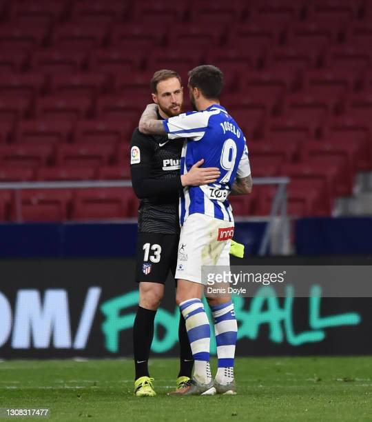 Jan Oblak of Atletico de Madrid is congratulated by Joselu of Deportivo Alaves after their side's victory after the La Liga Santander match between...