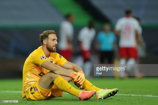 Jan Oblak of Atletico de Madrid looks dejected after his team concede during the UEFA Champions League Quarter Final match between RB Leipzig and...