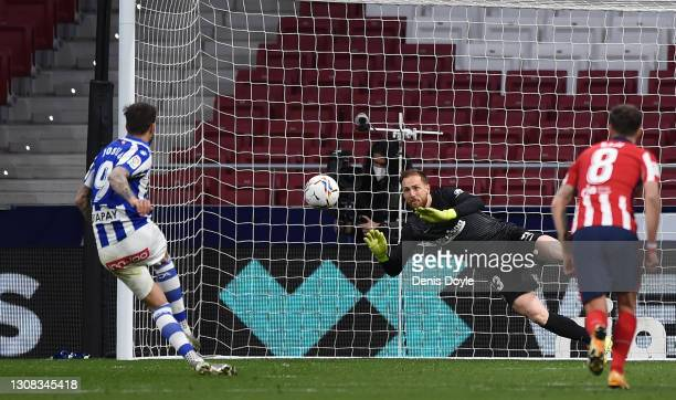 Jan Oblak of Atletico de Madrid saves a penalty from Joselu of Deportivo Alaves during the La Liga Santander match between Atletico de Madrid and...
