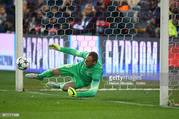 Jan Oblak of Atletico de Madrid Stops a penalty in the shoot out during the UEFA Champions League round of 16 2nd leg football match between Atletico...