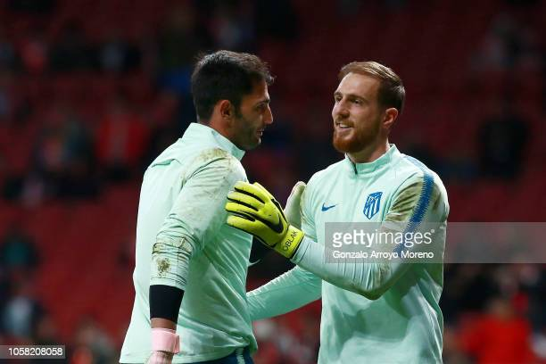 Jan Oblak of Atletico Madrid and Antonio Adan of Atletico Madrid warm up prior to the Group A match of the UEFA Champions League between Club...