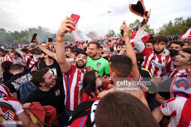 Jan Oblak of Atletico Madrid celebrates with fans outside the stadium following the La Liga Santander match between Real Valladolid CF and Atletico...