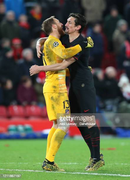 Jan Oblak of Atletico Madrid celebrates with Stefan Savic after the UEFA Champions League round of 16 second leg match between Liverpool FC and...