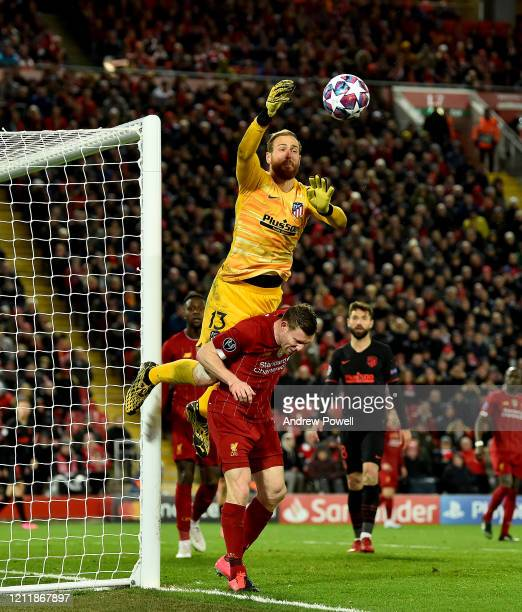 Jan Oblak of Atletico Madrid competing with James Milner of Liverpool during the UEFA Champions League round of 16 second leg match between Liverpool...