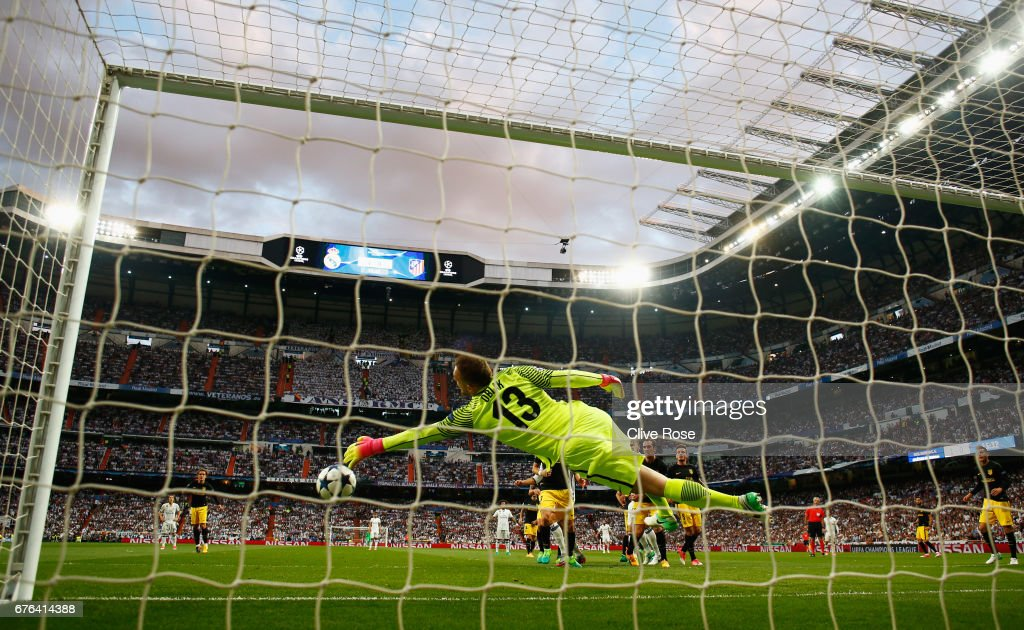 Jan Oblak of Atletico Madrid makes a save during the UEFA Champions League semi final first leg match between Real Madrid CF and Club Atletico de Madrid at Estadio Santiago Bernabeu on May 2, 2017 in Madrid, Spain.