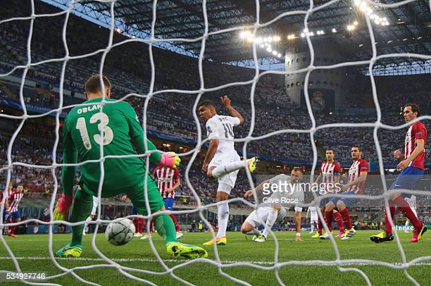 Jan Oblak of Atletico Madrid makes a save on Karim Benzema of Real Madrid d during the UEFA Champions League Final match between Real Madrid and Club...