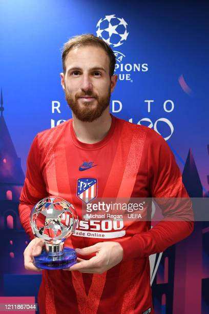 Jan Oblak of Atletico Madrid poses for a photo with the Player of the match award after the UEFA Champions League round of 16 second leg match...