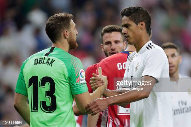 Jan Oblak of Atletico Madrid Raphael Varane of Real Madrid during the La Liga Santander match between Real Madrid v Atletico Madrid at the Santiago...