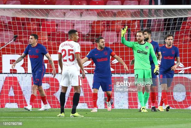 Jan Oblak of Atletico Madrid reacts after saving a penalty from Lucas Ocampos of Sevilla FC during the La Liga Santander match between Sevilla FC and...