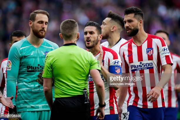 Jan Oblak of Atletico Madrid referee Hernandez Hernandez Koke of Atletico Madrid Felipe Monteiro of Atletico Madrid during the La Liga Santander...