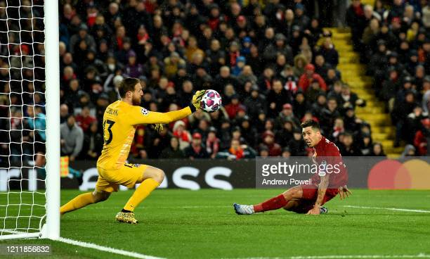 Jan Oblak of Atletico Madrid saves from Roberto Firmino of Liverpool during the UEFA Champions League round of 16 second leg match between Liverpool...