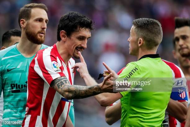 Jan Oblak of Atletico Madrid Stefan Savic of Atletico Madrid referee Hernandez Hernandez during the La Liga Santander match between Atletico Madrid v...