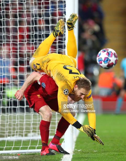 Jan Oblak of Atletico Madrid wins the ball from James Milner of Liverpool during the UEFA Champions League round of 16 second leg match between...