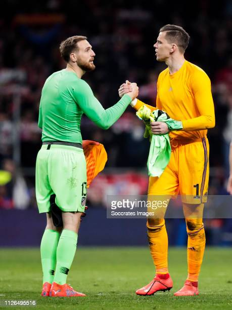 Jan Oblak of Atletico Madrid Wojciech Szczesny of Juventus during the UEFA Champions League match between Atletico Madrid v Juventus at the Estadio...