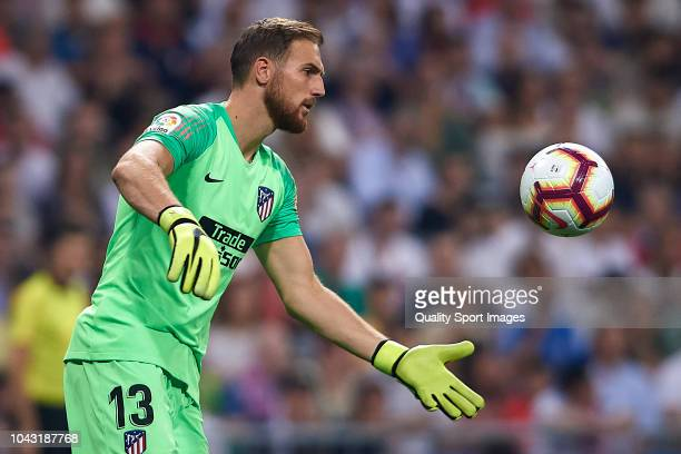 Jan Oblak of Club Atletico de Madrid in action during the La Liga match between Real Madrid CF and Club Atletico de Madrid at Estadio Santiago...