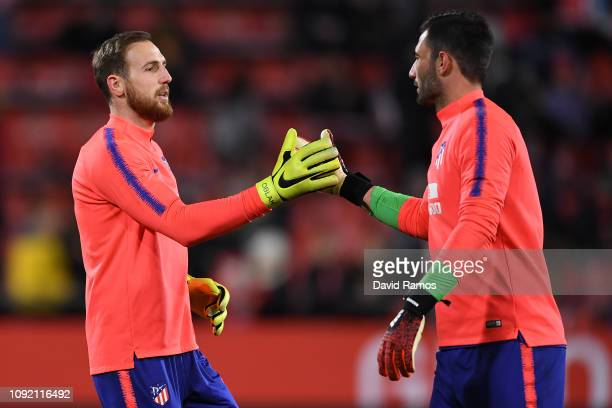 Jan Oblak shakes hands with his team mate Antonio Adan of Atletico de Madrid prior to the Copa del Rey Round of 16 match between Girona FC and...
