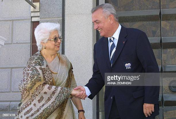 Jan Peteers of Belgium head of the FIFA inspection team shakes hands with Frene Ginwala Speaker of Parliament as the FIFA team depart from parliament...