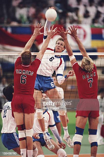 Jan Posthuma of the Netherlands returns against Craig Buck and Steve Timmons of the United States during their Men's Volleyball match on 24th...