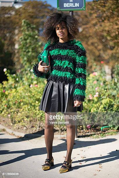 15224281d79b Jan Quammie poses wearing Miu Miu shoes before the Moncler Gamme Rouge show  at the Grand