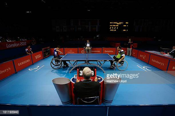 Jan Riapos of Slovakia competes against Kyung Mook Kim of Republic of Korea in the Men's Singles Table Tennis Class 2 on day 5 of the London 2012...