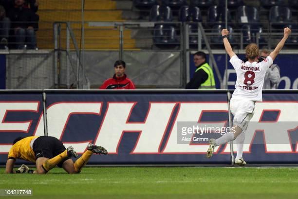 Jan Rosenthal of Freiburg celebrates after he scored his team's first goal against goalkeeper Oka Nikolov of Frankfurt during the Bundesliga match...